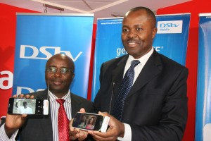 Airtel Kenya head of Corporate Communications and Brand Dick Omondi and DStv Mobile General Manager Felix Kyengo display the DStv Drifta during the partnership launch