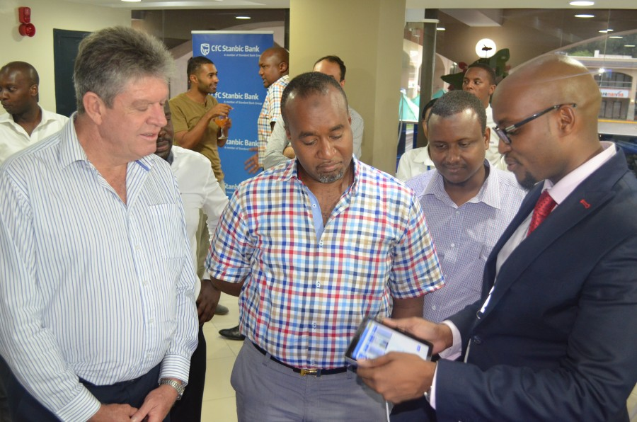 Chief guest (Mombasa Governor Hassan Joho being taken through the digital experience by the Head of E-channels Paul Ndichu and looking on is our Chief Executive Greg Brackenridge.