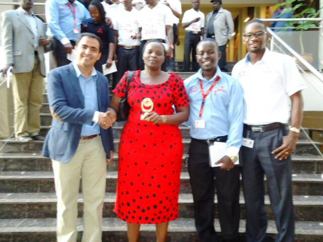 Airtel Kenya CEO Adil El Youssefi presents an award to Airtel Channel Partner Ann Aduda of Advico Services. Looking on is Airtel Busia Territory Manager Joram Asaka and Airtel Western Zonal Business Manager Davis Opil.