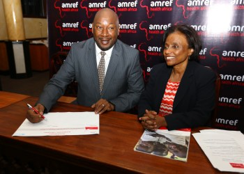 Samsung Electronics EA VP & COO Robert Ngeru with Amref Director General Dr. Teguest Guerma during the Amref Health Africa Roundtable at Serena Hotel, Nairobi_12th Aug. 2014