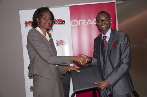 Equity Group Foundation Managing Director Helen Gichohi and Oracle Kenya Country Manager shake hands after joining forces on their corporate citizenship programs to launch the Oracle Academy Java Fundamentals training to grow ICT skills in Kenya.