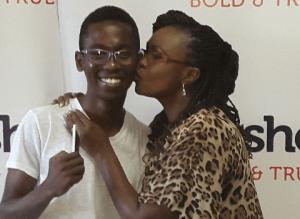 19-year-old architecture student at Nairobi Institute of Technology, Joe Karani Mpasho's first iPhone 6 winner with Carol Mutoko (IMG credits The STAR)
