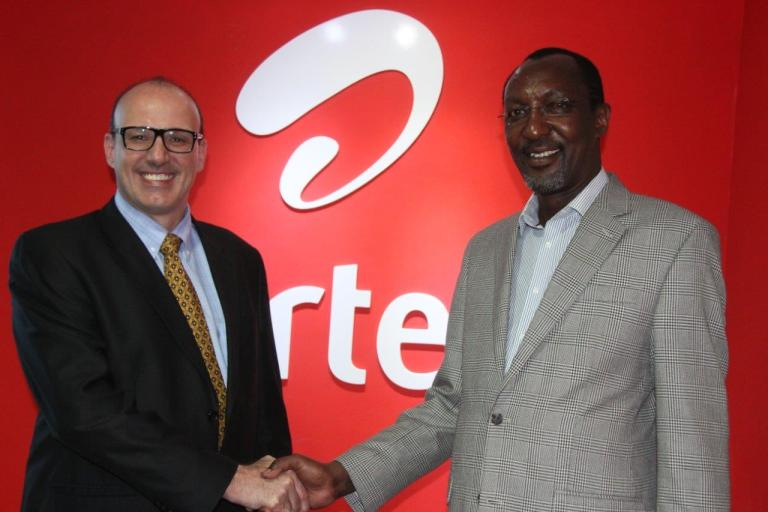 Airtel Africa Executive Operations Director Christophe Soulet (Left)  welcomes  Dr. Naikuni (right)