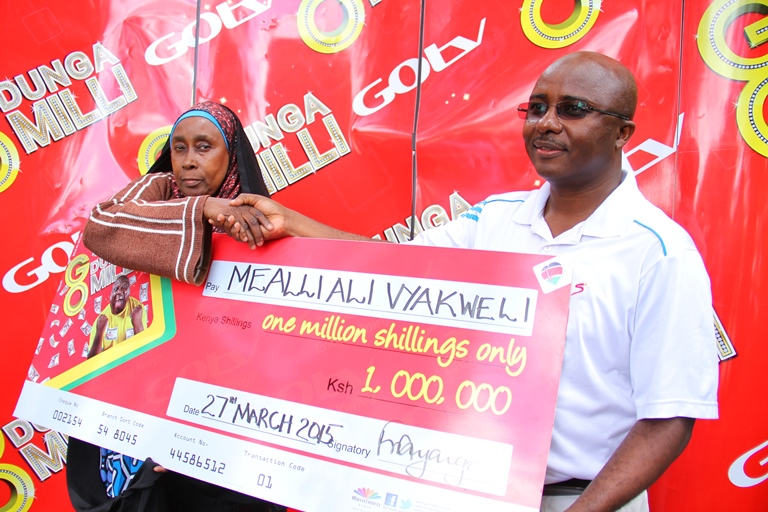 GOtv General Manager Felix Kyengo  presents Sh1 million to Meali Vyakweli for buying and activating a GOtv decoder in the ongoing  Dunga Milli promo
