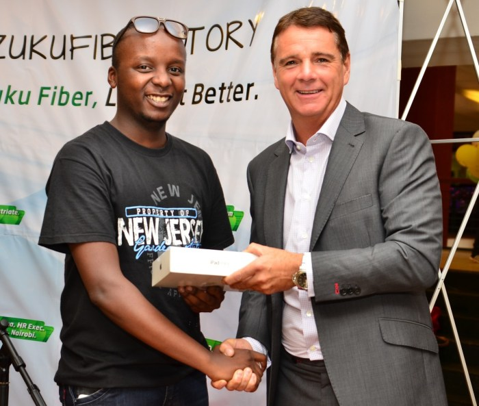 L-R, Kevin Oyugi, winner -(ipad), Richard Alden (CEO, Wananchi Group) 2