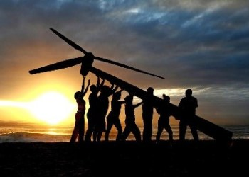 Greenpeace and Tcktcktck volunteers raise a wind turbine on the beach at dawn in Durban, South Africa. To send a message of hope for the latest round of UN climate change talks opening here on Monday. Campaigners say Durban must be a new dawn for the international negotiations to agree a fair, ambitious and legally binding treaty to avert climate chaos. They are demanding that politicians stop listening to the polluting corporations and listen to the people who want an end to our dependence on fossil fuels. Africa is on the front line of dangerous climate change, with millions already suffering the impacts through increased drought and extreme weather events, threatening lives and food security.