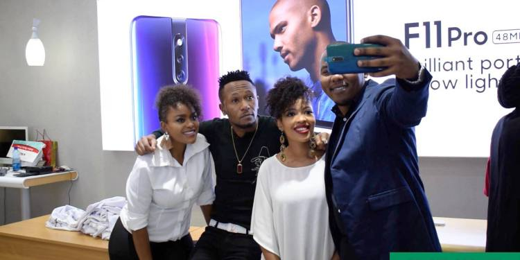 OPPO Kenya Product Manager Ernest Teigut (right) takes a selfie with Gospel artiste Kambua Manundu (second right), Samuel Muraya (DJ Mo) and Singer Judith Nyambura (Avril - left) when the global smartphone brand began sale of F11 Pro and F11 phones in Kenya yesterday.