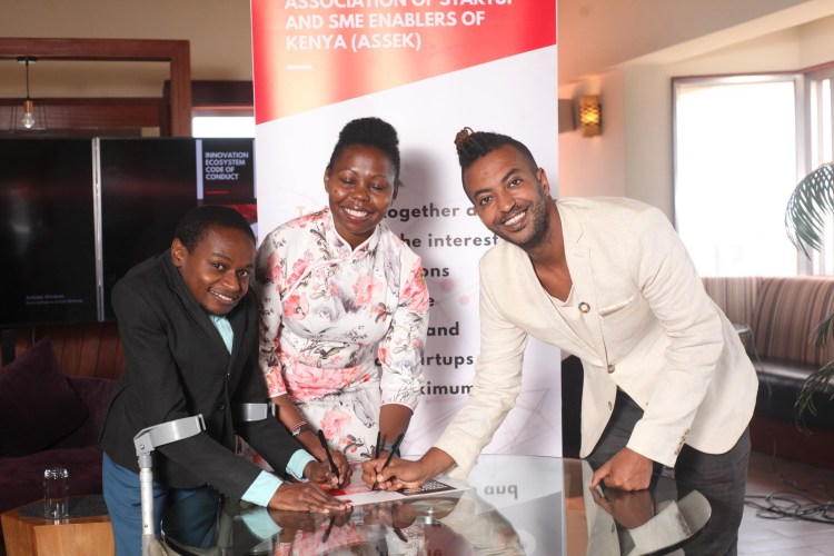 Caption: Mr. Bernard Chiira, ASSEK Chairperson and Ms. Anne Lawi , PANGEA Accelerator Country Director and Mr.Jonas Tesfu PANGEA Accelerator Founder sign the Code of Conduct at Movenpick Hotel Westlands. The Code of Conduct is aimed at creating fair engagement among various stakeholders.
