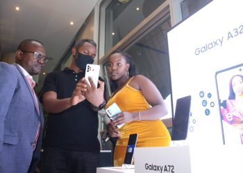 Samsung trainer Nebert Njoka (C) showcases the newly launched Samsung A72 to Samsung Kenya Head of Integrated Mobile Mr. Charles Kimari (L) and Samsung Brand Ambassador Nikita Kering (R) during the Samsung A Series launch at the Urban Eatery in Nairobi Kenya on the 17thof March 2021