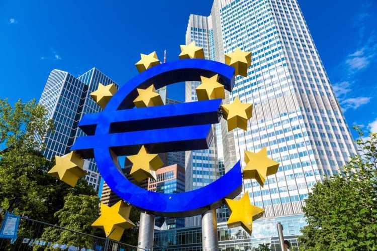 FRANKFURT, GERMANY - JULY 9: Euro sign. European Central Bank headquarters in Frankfurt in Germany in summer day on July 9, 2014 in Frankfurt, Germany.
