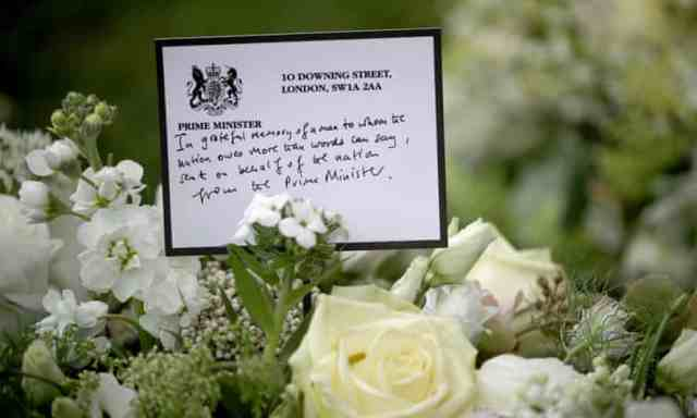 A wreath sent by Boris Johnson is among floral tributes outside St George's chapel at Windsor Castle.