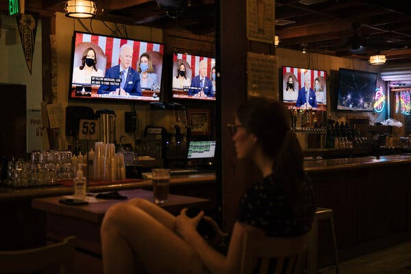 President Biden's address to a joint session of Congress was on the screens at The Brig, a beer garden in in Washington, on Wednesday night.