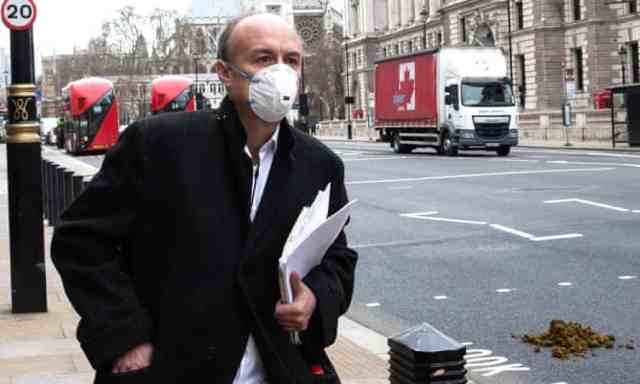 Dominic Cummings wearing face mask and walking near Parliament Square