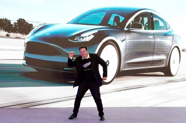 Musk dances onstage during a delivery event for Tesla China-made Model 3 cars in Shanghai, China, in January last year