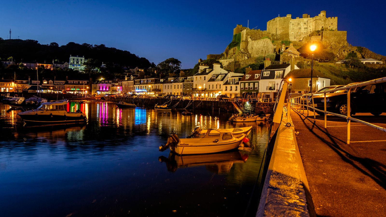 Mont Orgueil Castle, viewed from Gorey Pier at dusk, Gorey, Jersey, Channel Islands stock photo