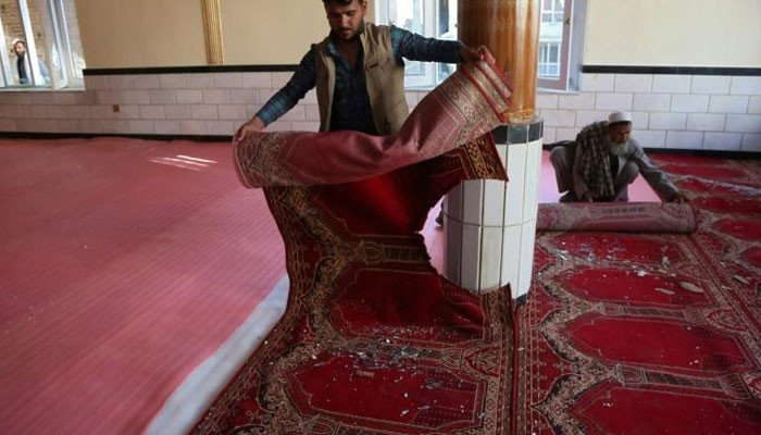 Warring Afghan sides discuss peace talks as deadly blast hits mosque