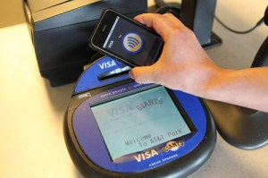 A smartphone making a payment through an NFC enabled terminal