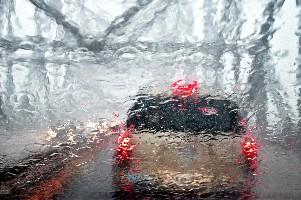 Rain on windshield, on a bridge (Bob Jagendorf/Flickr)