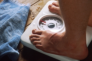 Feet on bathroom scale (Genome.gov)