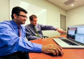 Phani Teja Kuruganti (foreground) and James Nutaro (Oak Ridge National Lab)