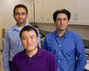 Shanhui Fan, center, with graduate students Aaswath Raman, left, and Eden Rephaeli.
