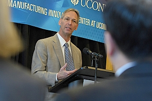 Pratt & Whitney's Paul Adams speaking at the opening the Additive Manufacturing Center at University of Connecticut.