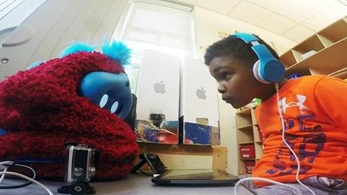Preschooler interacts with robot