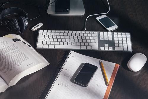 Keyboard, phone, notebook