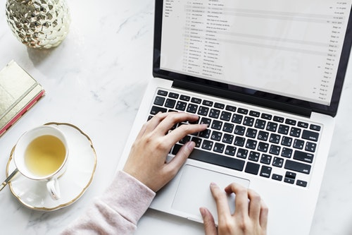 Hands on keyboard, cup of tea