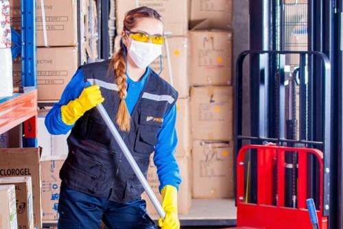 Warehouse worker with mop