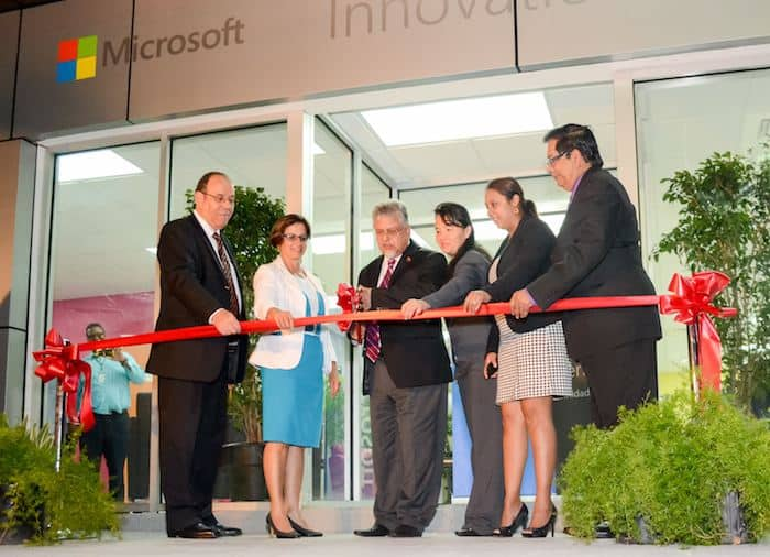CARIRI Chairman Hayden Ferreira, left, Microsoft Country Manager Frances Correia, Minister of Planning Dr Bhoendradatt Tewarie, Microsoft Senior Technology Marketing Manager Elisa Hung, Couva North MP Ramona Ramdial, and CARIRI CEO Liaquat Ali Shah, cut the ribbon to officially open the Microsoft Innovation Centre at the Centre for Enterprise Development in Freeport.
