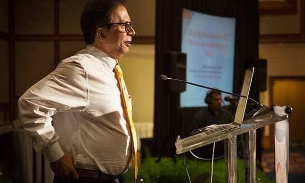 Professor Abhijit Bhattacharya delivers the feature address at a recent TATT event. Photo by Mark Lyndersay.