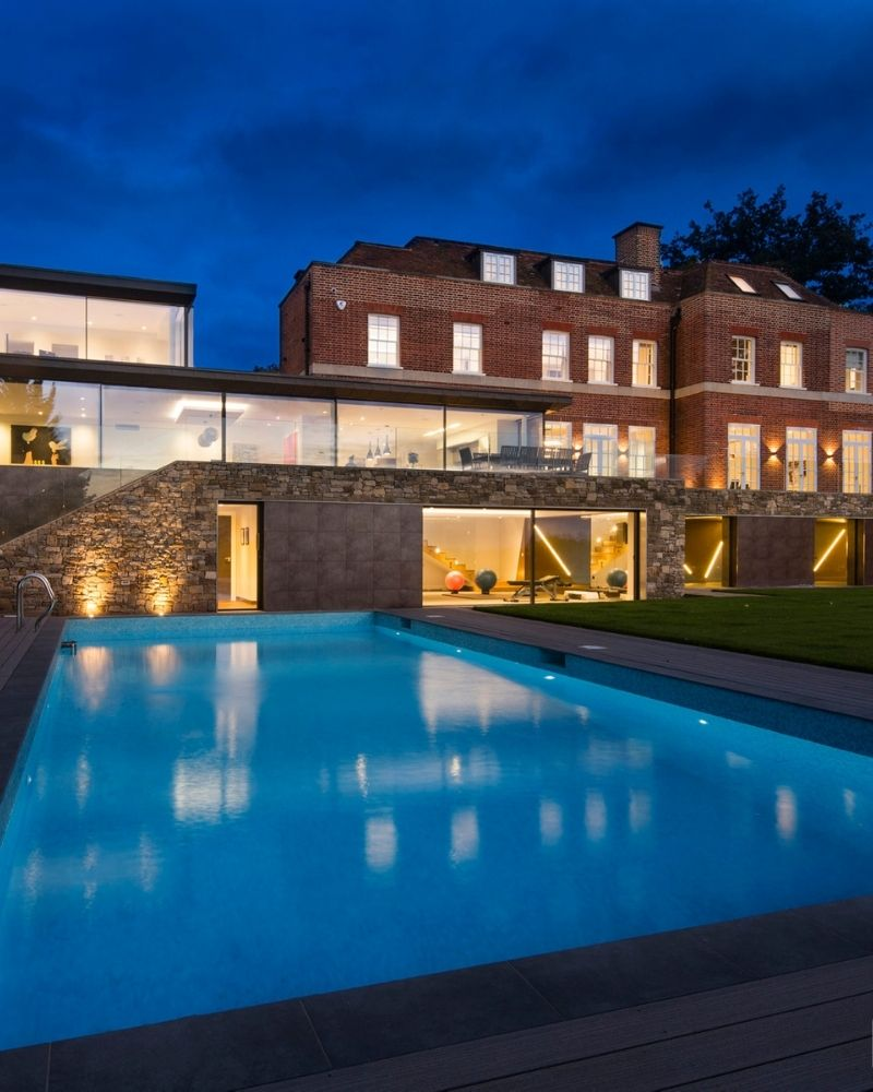 an outdoor swimming pool outside contemporary home in cornwall