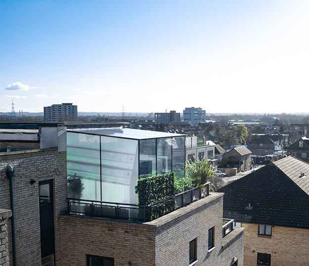 Rooftop glass box extension with solar control glass