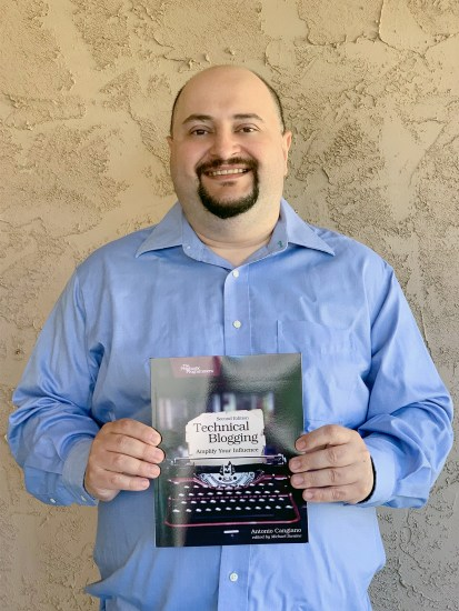 Me holding Technical Blogging (2nd Edition)