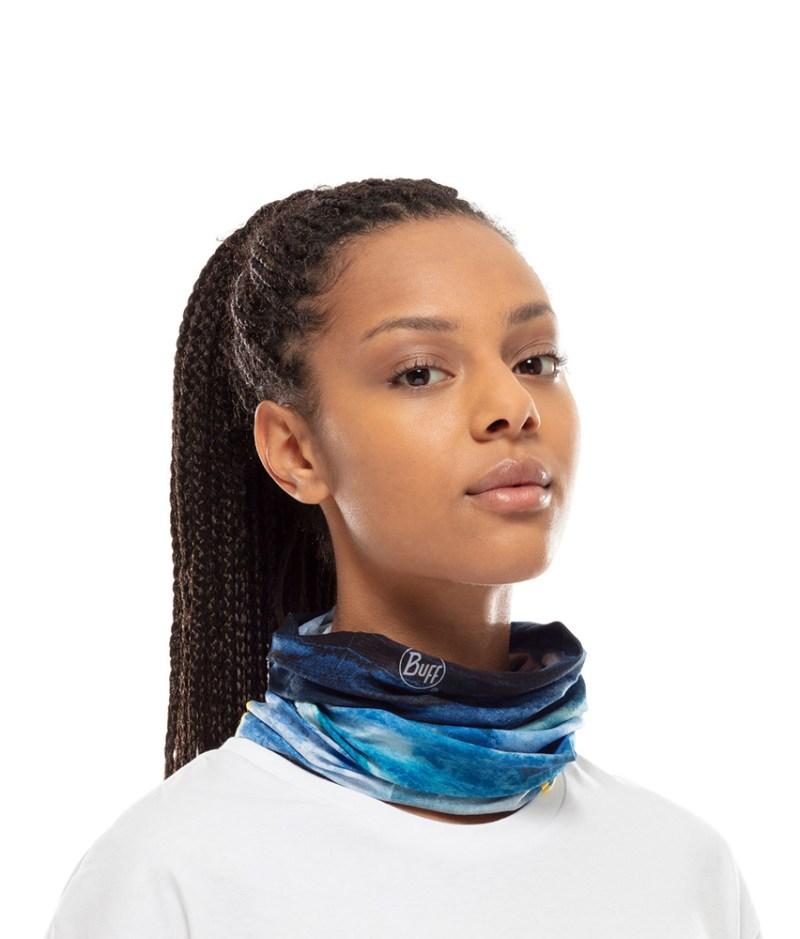 "Studio photo of a Woman wearing the BUFF® Coolnet UV+ National Geographic Collection Design ""Zankor Multi"". Source: buff.eu"
