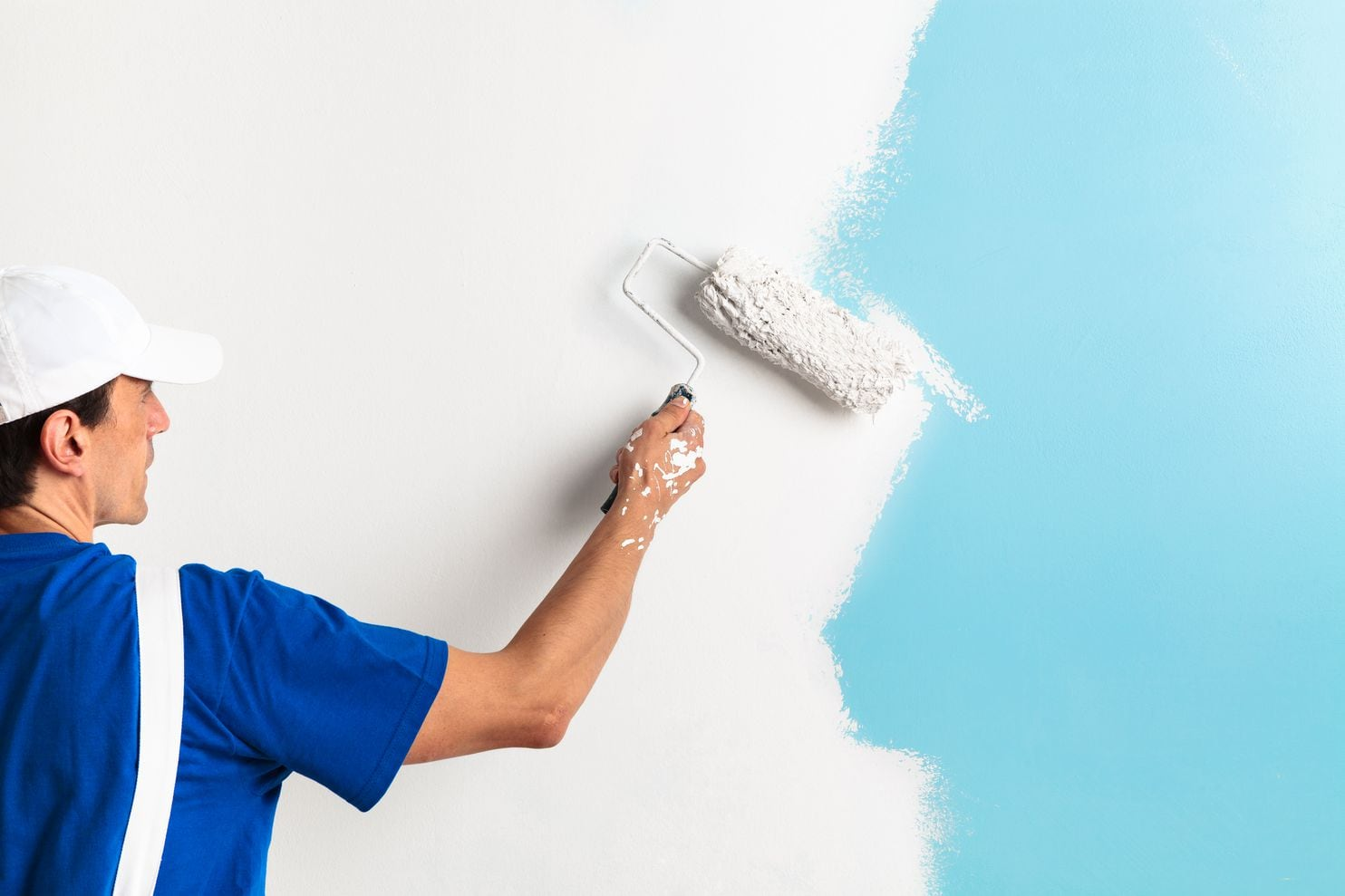 Why White is mostly worn by Professional Painters?