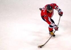 Flex du bâton de hockey en action