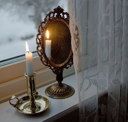 candle reflection flat mirror surface