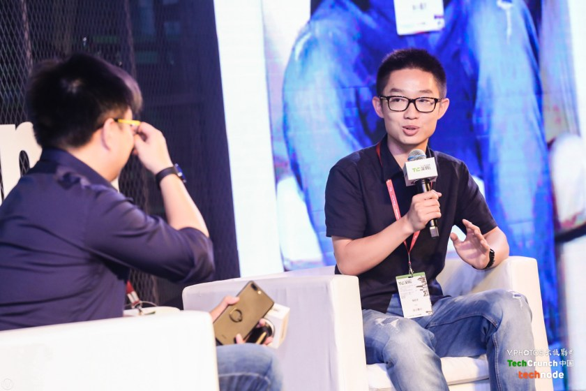 Austin Zhang being interviewed on stage by TechNode founder Lu Gang