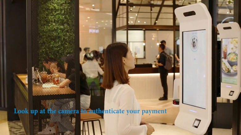 """Alibaba's  """"Smile to Pay"""" facial recognition system. Screenshot from Alibaba's promotional video."""