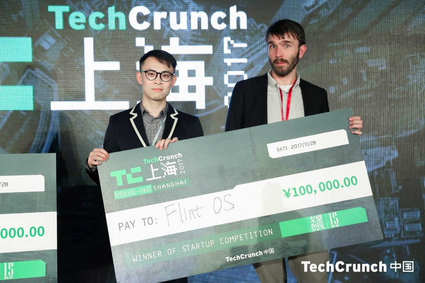 Alpha Tang of Flint OS taking his prize from TechCrunch's Matthew Linley (Image credit: TechCrunch Shanghai)