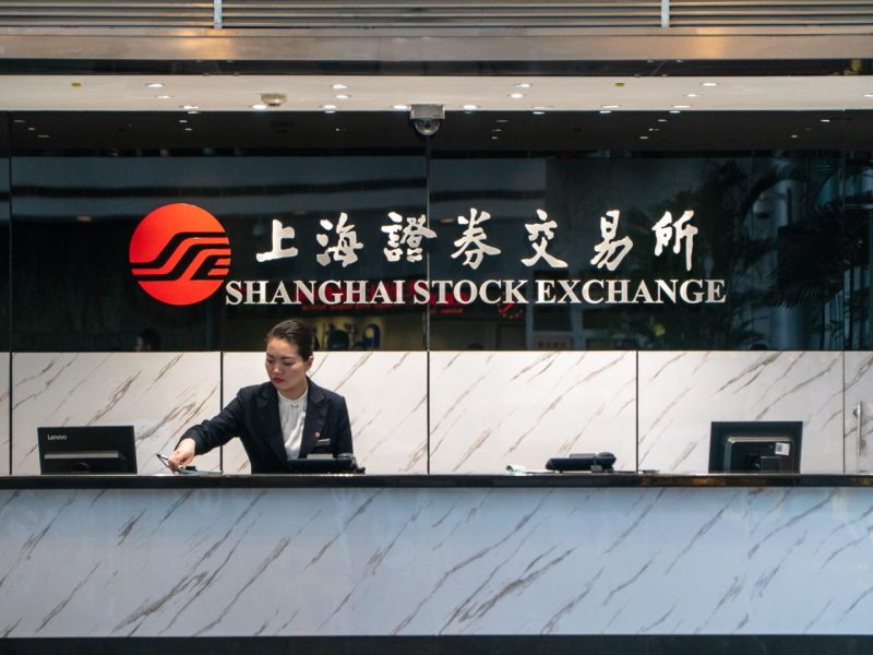 A concierge collating documents at the Shanghai Stock Exchange located at the Lujiazui Financial District in Pudong, China on April 4, 2019. (Image Credit: TechNode/Eugene Tang)