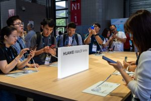 Attendees try Huawei's Mate 20 Pro at CES Asia 2019 in Shanghai, China on June 11, 2019. (Image credit: TechNode/Shi Jiayi)