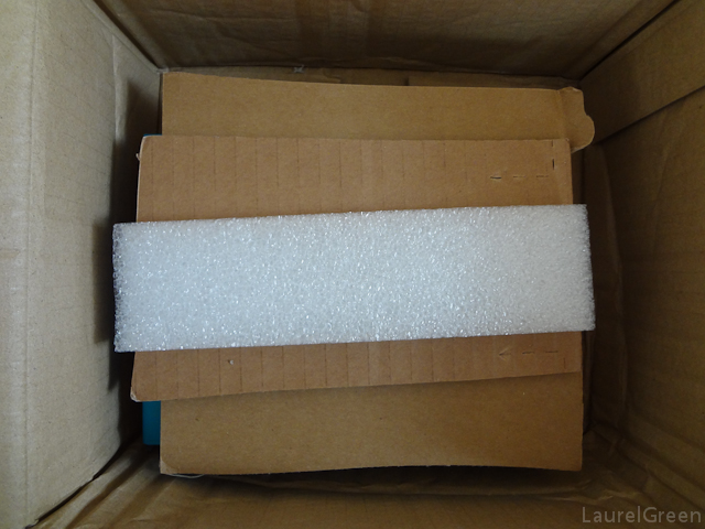 a photo of random pieces of foam and cardboard padding a box
