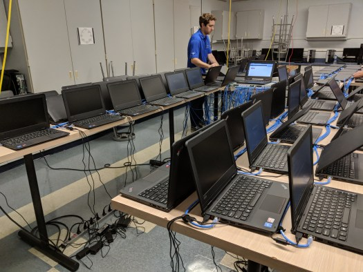 Rows of student laptops