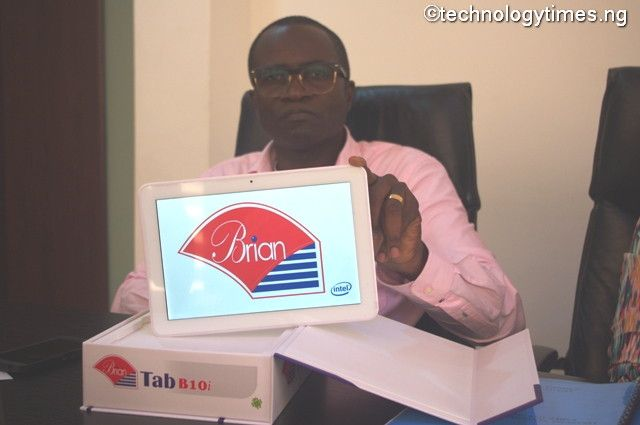 Tunji Balogun, Chairman of Brian Integrated Systems, makers of the Brain range of computers displays the newly launched BrianTab B10i to Technology Times