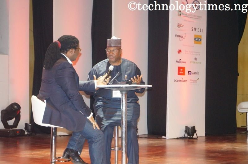 Mr John Momoh, CEO of Channels TV (right) seen speaking at the DEMO Africa 2014 in Lagos. Backing the camera is Victor Okigbo