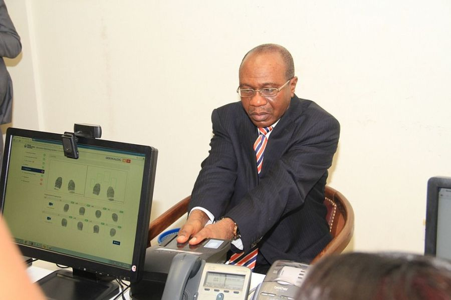 Mr. Godwin Emefiele, Governor of the Central Bank of Nigeria (CBN), undergoing a biometric verification exercise