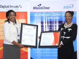 Lynda Madu, General Manager, Corporate Services & Development, MainOne and Adedoyin Odunfa, MD/CEO, Digital Jewels, during the presentation of ISO 27001 and PCI DSS certificates to MainOne's Data Centre subsidiary, MDX-I in Lagos.